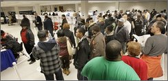 Voters wait at the polls at the Cuyahoga County Board of Elections in Cleveland, Ohio on Thursday, Oct. 30, 2008, as they lined up for early voting. (AP Photo/Amy Sancetta)