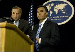 Drug Enforcement Administration assistant administrator and chief of intelligence Anthony Placido, left, and Mexican Federal Police Under Secretary for Intelligence and Strategy Facundo Rosas speak at a news conference Monday, Oct. 27, 2008, in Washington, to announce the capture of drug kingpin Eduardo Arellano Felix.  (AP Photo/Evan Vucci)