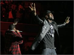 NBA superstar LeBron James, right, and Grammy-winning recording artist Jay-Z rally voters at a concert, urging them to vote early for Democratic presidential nominee Barack Obama Wednesday, Oct. 29, 2008, in Cleveland.(AP Photo/Tony Dejak)
