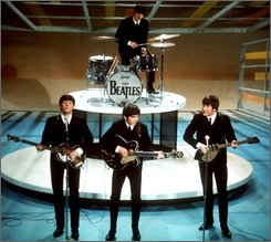 "In this Feb. 9, 1964 file photo, The Beatles perform on the CBS ""Ed Sullivan Show"" in New York. (AP Photo, file)"