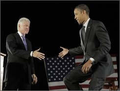 Democratic presidential candidate Sen. Barack Obama, D-Ill., right, shakes hands with former president Bill Clinton at a rally at Osceola Heritage Park in Kissimmee, Fla., Wednesday, Oct. 29, 2008.(AP Photo/Jae C. Hong)