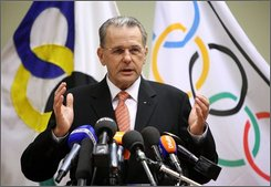 IOC president Jacques Rogge gestures as he announces his candidacy for a second term as IOC President at the Belgian Olympic International Committee in Brussels, Thursday Oct. 30, 2008.  (AP Photo/Geert Vanden Wijngaert)