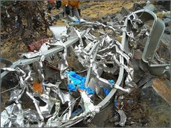 This Friday, Oct. 3, 2008 picture provided by the Madera County Sheriff's Department shows wreckage of the motor from Steve Fossett's plane near Mammoth Lakes, Calif. Searchers have found what appear to be two large human bones near the crash site of Fossett's plane in California's Sierra Nevada, along with the adventurer's tennis shoes and driver's license, authorities said Thursday, Oct. 30, 2008. (AP Photo/Madera County Sheriff's Department)