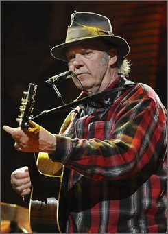 "In this Saturday, Sept. 20, 2008 file photo, Neil Young performs during Farm Aid 2008 in Mansfield, Mass. Young decided he wouldn't be ""Rockin' in the Free World"" at The Forum in Los Angeles on Thursday night, Oct. 30, 2008. (AP Photo/Lisa Poole)"