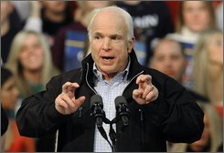 Republican presidential candidate Sen. John McCain, R-Ariz., uses finger quotes while speaking about Democratic presidential candidate Sen. Barack Obama, D-Ill., during a rally at Mentor High School in Mentor, Ohio Thursday, Oct. 30, 2008. (AP Photo/David Richard)