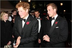 Britain's Prince Harry, left, and Prince William, right, arrive for the premier of the new James Bond movie Quantum of Solace in central London Wednesday Oct. 29, 2008 (AP Photo/Darren Fletcher, Pool)