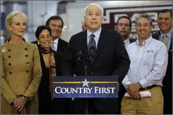 Republican presidential candidate Sen. John McCain, R-Ariz., prepares to give a brief statement during a campaign stop at Baron Sign Manufacturing in Riviera Beach, Fla. on Wednesday, Oct. 29, 2008. (AP Photo/Pool, Alex Boerner)