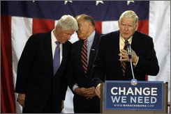 Rep. John Murtha, D-Pa., speaks as former U.S. President Bill Clinton and Pennsylvania Governor Ed Rendell chat during a rally for presidential candidate Sen. Barack Obama, D-Ill., at Washington and Jefferson College in Washington, Pa., Wednesday, Oct. 29, 2008. (AP Photo/David Guttenfelder)
