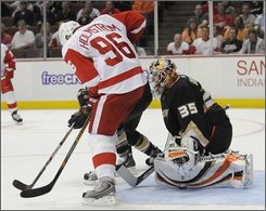 Detroit Red Wings right wing Tomas Holmstrom, of Sweden, watches a shot by center Pavel Datsyuk, not seen, of Russia, slide under the glove of Anaheim Ducks goalie Jean-Sebastien Giguere for a goal in the first period of an NHL hockey game in Anaheim, Calif., Wednesday, Oct. 29, 2008. (AP Photo/Chris Carlson)