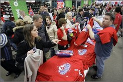 Fans crowd a Modell's sporting goods store to buy Philadelphia Phillies World Series baseball merchandise in Philadelphia, Thursday, Oct. 30, 2008.  The Phillies defeated the Tampa Bay Rays 4-3 to win the series Wednesday.  (AP Photo/Matt Rourke)