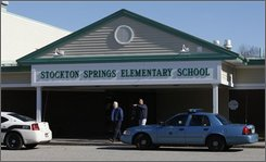 Ray Freve, superintendent of schools for MSAD 56, left, and Jim Parsons, transportation and maintenance supervisor, examine the scene at the Stockton Springs Elementary School, Friday, Oct. 31, 2008, in Stockton Springs, Maine. Police say a gunman, Randall Hofland, 55, walked inside a classroom and held 11 pupils hostage before giving himself up. State and local police responded and the Hofland was taken into custody. (AP Photo/Robert F. Bukaty)