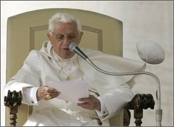 A gust of wind blows away Pope Benedict XVI's cap as he delivers his message during his weekly general audience in St. Peter's Square at the Vatican, Wednesday, Oct. 29, 2008. (AP Photo/Pier Paolo Cito)