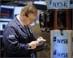A trader works on the floor of New York Stock Exchange Thursday, Oct. 30, 2008. (AP Photo/Richard Drew)