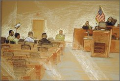 In this May 7, 2008 file photo of a drawing by sketch artist Janet Hamlin and reviewed by U.S. Military officials, Guantanamo detainee Ali Hamza al-Bahlul, far left, holds up a handwritten sign that says ?boycott? in Arabic and English, in the U.S. military courtroom in Guantanamo Bay, Cuba.  The military tribunal of al-Bahlul, accused of creating propaganda for Osama bin Laden, begins Monday, Oct. 27, 2008, with or without the defendant in the courtroom, according to officials. (AP Photo/Janet Hamlin, File)