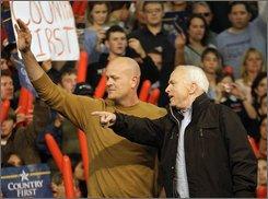 Republican presidential candidate Sen. John McCain, R-Ariz., right, and Samuel 'Joe The Plumber' Wurzelbacher arrive at a rally at Mentor High School in Mentor, Ohio Thursday, Oct. 30, 2008. (AP Photo/David Guttenfelder)