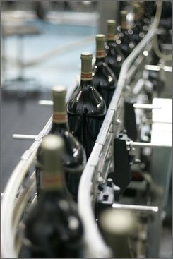 New, lighter 1.5 liter bottles of Cabernet Sauvignon move along a bottling line at Fetzer Vineyards in Hopland, Calif., Thursday, Oct. 16, 2008. Thin is in at Fetzer Vineyards, at least when it comes to wine bottles. The Northern California winery is switching to a lighter weight glass to cut shipping costs and give the environment a break. (AP Photo/Eric Risberg)