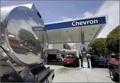 In this Aug. 4, 2008 file photo, the reflection from a gas tanker truck is shown at a Chevron gas station in San Francisco. Chevron Corp. said Friday, Oct. 31, 2008, its third-quarter profit more than doubled on the back of record crude prices this summer. (AP Photo/Paul Sakuma, file)