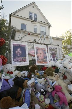 Chicago Police gather evidence on the city's West Side, Wednesday, Oct. 29, 2008, near the site where 7-year-old Julian King, nephew of singer and Oscar winner Jennifer Hudson, was found shot to death in an SUV on Monday. (AP Photo/NAm Y. Huh)