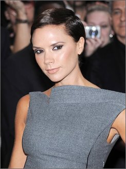 "In this Sept. 26, 2008, file photo, Victoria Beckham attends a ""Beckham Signature"" fragrance launch event at Macy's in New York. Beckham will strip down to her underwear in ads for the new Armani lingerie line. The former ""Posh Spice"" will debut in the spring-summer 2009 advertising campaign of Emporio Armani women's underwear. (AP Photo/Evan Agostini, file)"
