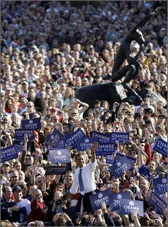 Democratic presidential candidate Sen. Barack Obama, D-Ill. waves as he enters a rally at Western Gateway Park in Des Moines, Iowa Friday, Oct. 31, 2008. (AP Photo/Alex Brandon)