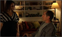 """In this image released by Strike.TV, Joanne Whalley, left, and Timothy Dalton are shown in a scene from, """"Unknown Sender,"""" directed and produced by Steven E. de Souza. (AP Photo/Strike.TV)"""