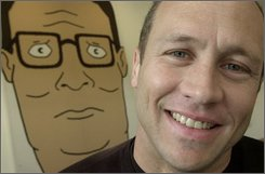 "Mike Judge, co-creator of the Fox cartoon series ""King of the Hill,"" poses in front of an illustration of Hank Hill,  the animated character he voices, in this Oct. 28, 2002, file photo made in Los Angeles. ""King of the Hill"" is over the hill at Fox, which is canceling the long-running animated comedy. Final episodes of the half-hour series, now in its 13th year, likely will air during the 2009-10 season, Fox said Friday Oct. 31, 2008.  (AP Photo/Ric Francis, FILE)"