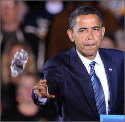 Democratic presidential candidate Sen. Barack Obama, D-Ill., throws a bottle of water to a supporter in the crowd who had passed out during a rally at Wicker Memorial Park in Highland Ind., Friday, Oct. 31, 2008.(AP Photo/Paul Beaty)