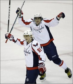 Washington Capitals center Sergei Fedorov (91), of Russia, and left wing Alex Ovechkin, top, of Russia, celebrate a goal by Fedorov in the first period of an NHL hockey game against the Dallas Stars, Saturday, Oct. 25, 2008, in Dallas. (AP Photo/Matt Slocum)