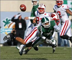 Michigan State's B.J. Cunningham (3) is unable to hang on to a pass while defended by Wisconsin's Shane Carter during the first quarter of an NCAA college football game Saturday, Nov. 1, 2008, in East Lansing, Mich. (AP Photo/Al Goldis)