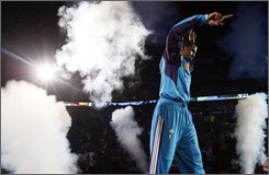 New Orleans Hornets guard Chris Paul takes the court before the Hornets' home opener NBA basketball game against the Cleveland Cavaliers in New Orleans, Saturday, Nov. 1, 2008. (AP Photo/Ann Heisenfelt)