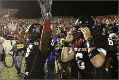 Texas Tech wide receiver Michael Crabtree (5) lifts up his arms after he caught the game-winning pass from quarterback Graham Harrell (6) in the final seconds of an NCAA college football game against Texas in Lubbock, Texas, Saturday, Nov. 1, 2008. Texas Tech won 39-33. (AP Photo/LM Otero)