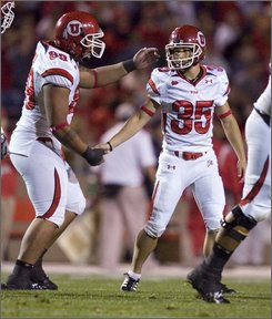 Utah's Louie Sakoda (35) is congratulated by tight end Neli A'asa (89) after Sakoda kicked a field goal during a NCAA college football game against New Mexico in Albuquerque, N.M., on Saturday, Nov. 1, 2008. (AP Photo/Craig Fritz)