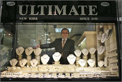 Gem Sezgin poses for a portrait at his store Ultimate Jewelry Designs in the Diamond district of Manhattan, Friday, Oct. 17, 2008 in New York.  As the luxury jewelry market loses its luster, jewelers are looking toward the crucial holiday season -- a time for gifts as well as a popular time to get engaged -- with trepidation. (AP Photo/Mary Altaffer)