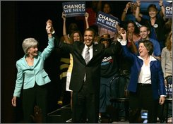 In this Sept. 20, 2008 file photo, Democratic presidential candidate Sen. Barack Obama, D-Ill., center, holds the hands of Kansas Gov. Kathleen Sebelius, left, and Arizona Gov. Janet Napolitano during a rally in Daytona Beach, Fla. Americans will elect not only a president on Tuesday Nov. 4, but also his huge team of aides, advisers and bureaucrats who will help the winner run the federal government for the next four years. If Obama wins, people close to him believe he would offer jobs to some or all of a quartet of Democratic governors.  Napolitano is seen as a possible attorney general. Sebelius is mentioned as a possible secretary of Education, Commerce, Energy or Health and Human Services. (AP Photo/Reinhold Matay, File)