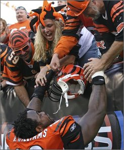 Cincinnati Bengals guard Bobbie Williams, bottom, celebrates with fans after defeating the Jacksonville Jaguars 21-19 in an NFL football game, Sunday, Nov. 2, 2008, in Cincinnati. (AP Photo/Tony Tribble)