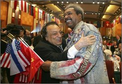  World Boxing Council President Jose Sulaiman, left, hugs U.S. boxing promoter Don King, right, during an opening ceremony of the 46th WBC World Convention in Chengdu, southwest China's Sichuan province, Monday, Nov. 3, 2008. Don King will stage four WBC bouts in the Chinese city on Nov. 7, including a main card between heavyweight boxers Andrew Golota of Poland and Ray &quot;The Rainman&quot; Austin of the U.S. (AP Photo/Color China Photo)