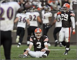 Cleveland Browns quarterback Derek Anderson (3) sits on the turf after throwing an interception that Baltimore Ravens linebacker Terrell Suggs returned for a touchdown in the fourth quarter of an NFL football game Sunday, Nov. 2, 2008, in Cleveland. Baltimore won 37-27. (AP Photo/Tony Dejak)