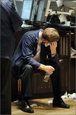 In this Oct. 24, 2008 file photo, a specialist sits at his post on the floor of the New York Stock Exchange. Wall Street capped another difficult week with steep losses October is often rough on the stock market and this year is no exception with the Dow Jones industrial average down 16.5 percent. But the month that brought the 1929 stock market crash that kicked off the Great Depression and 1987's Black Monday can also help change the market's fortunes. Investors should consider that October has also launched the reversal of 11 bear markets since World War II, according to the Stock Trader's Almanac.  (AP Photo/Richard Drew, file)