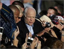 Republican presidential candidate Sen. John McCain, R-Ariz. greets supporters after speaking at an airport rally in Indianapolis, Monday, Nov. 3, 2008.  (AP Photo/Michael Conroy)