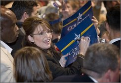 Republican vice presidential candidate Alaskan Gov.Sarah Palin signs autographs during her campaign stop at the Reno, Nev., Livestock Events Center Monday, Nov 3, 2008.(AP Photo/Scott Sady)