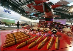 A model of the J-10 Chinese fighter jet with examples of its payload a day before the opening of the 7th China international aviation and aerospace exhibition in Zhuhai, southern China's Guangdong province on Monday, Nov 3, 2008.  (AP Photo/EyePress)