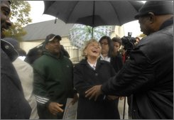 Democratic Gubernatorial candidate Lt. Gov. Beverly Perdue laughs as a supporter tells her she is prettier in person during her visit to a voting precinct in Durham, N.C, Tuesday, Nov. 4, 2008. (AP Photo/ Sara D. Davis)