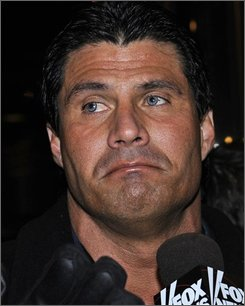 In this Dec. 13, 2007 file photo, former major league baseball player Jose Canseco exits the Grand Hyatt Hotel in New York. Canseco was sentenced Tuesday Nov. 4, 2008 in San Diego to 12 months unsupervised probation after pleading guilty in federal court to a misdemeanor offense of trying to bring a fertility drug across the border from Mexico. (AP Photo/ Louis Lanzano, File)