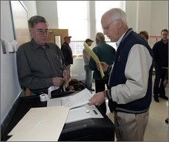 Incumbent Republican U.S. Rep.Christopher Shays, right,  feed his ballot into a scanner at Black Rock School in Bridgeport, Conn.,  Tuesday, Nov. 4, 2008. Shays is being challenged by Democrat Jim Himes. (AP Photo/Bob Child)