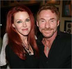 In this Feb. 9, 2007 file photo originally provided by the Hard Rock Cafe, Danny Bonaduce, right, and his wife Gretchen, left, pose for photographers during an event inside the Hard Rock Cafe at Universal City Walk in Los Angeles.  (AP Photo/Hard Rock Cafe, Rene Macura, file)