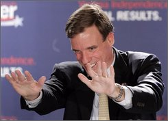 Democratic US Senator-elect, Mark Warner waves to the crowd as he delivers a victory speech in McLean, Va., Tuesday, Nov. 4, 2008. (AP Photo/Steve Helber)