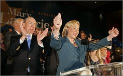 U.S. Sen. Mary Landrieu, D-La. delivers her victory speech along with her husband Frank Snellings at her election night headquarters  in New Orleans,  Tuesday, Nov. 4, 2008.   (AP Photo/Bill Haber)