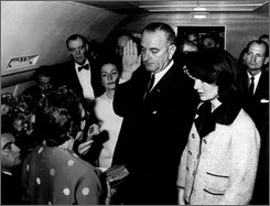 Lyndon B. Johnson is sworn in as President of the United States of America in the cabin of the presidential plane as Mrs. Jacqueline Kennedy stands at his side in this Nov. 22,1963 file photo. Cecil Stoughton, the White House photographer who shot the iconic image of Lyndon B. Johnson taking the oath of office aboard Air Force One, has died. He was 88. Stoughton died Monday Nov. 3, 2008 evening at his Florida home, his son Jamie Stoughton said Tuesday. Judge Sarah T. Hughes, a Kennedy appointee to the Federal court, left, administers the oath. In background, from left are, Jack Valenti, admistrative assistant to Johnson; Rep. Albert Thomas, D-Tex.; Mrs. Johnson; and Rep. Jack Brooks,D-Tex. (AP Photo/White House, Cecil Stoughton, FILE)