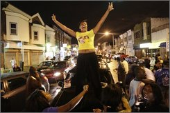 People take to the streets to celebrate the news that Barack Obama has been elected President of the United States, in Philadelphia, Tuesday, Nov. 4, 2008. (AP Photo/Matt Rourke)