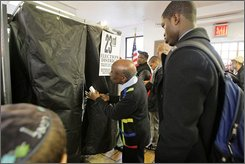 Election coordinator Feller Jean, center, assists a woman who was having difficulty with a voting machine at St. Marks Day School in the Crown Heights section of Brooklyn in New York, Tuesday, Nov. 4, 2008.  The neighborhood is a mixture of West Indian immigrants and Hasidic Jews. (AP Photo/Kathy Willens)